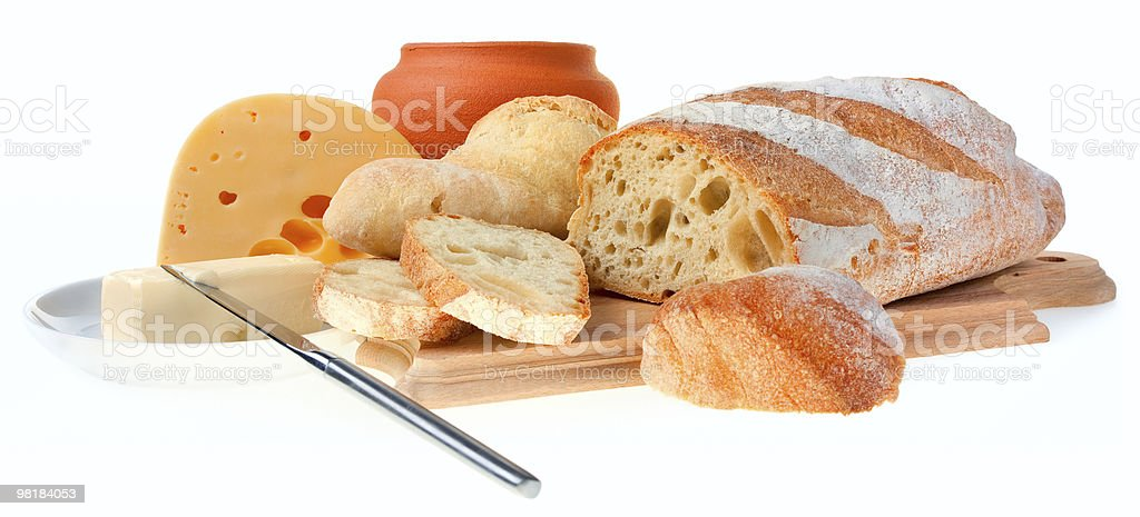 piece of butter, bread and a knife royalty-free stock photo