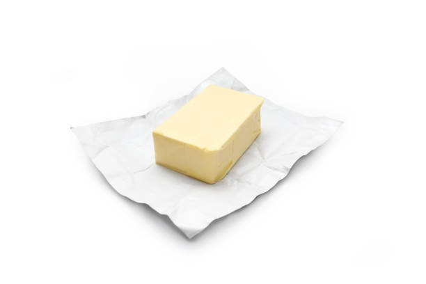 Piece of butter stock photo