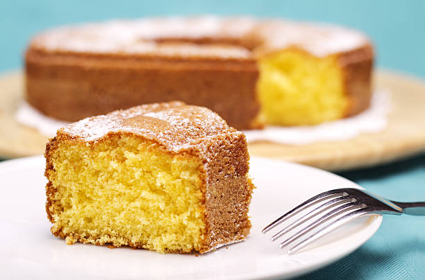 piece of cake with icing sugar stock photo