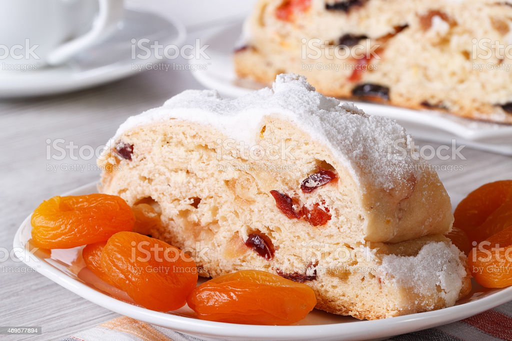 piece of cake with raisins, dried apricots and candied stock photo