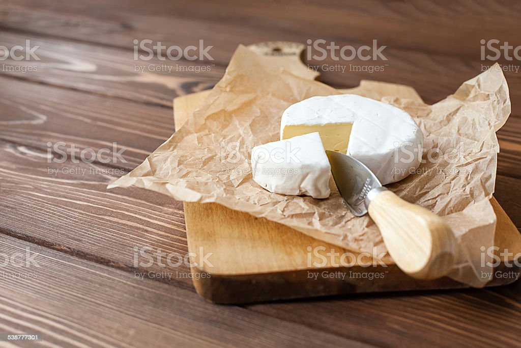 piece of Camembert with knife stock photo