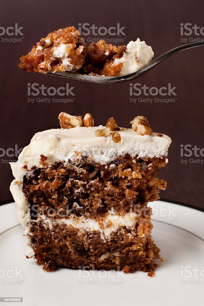 Piece of carrot cake with forkful above royalty-free stock photo