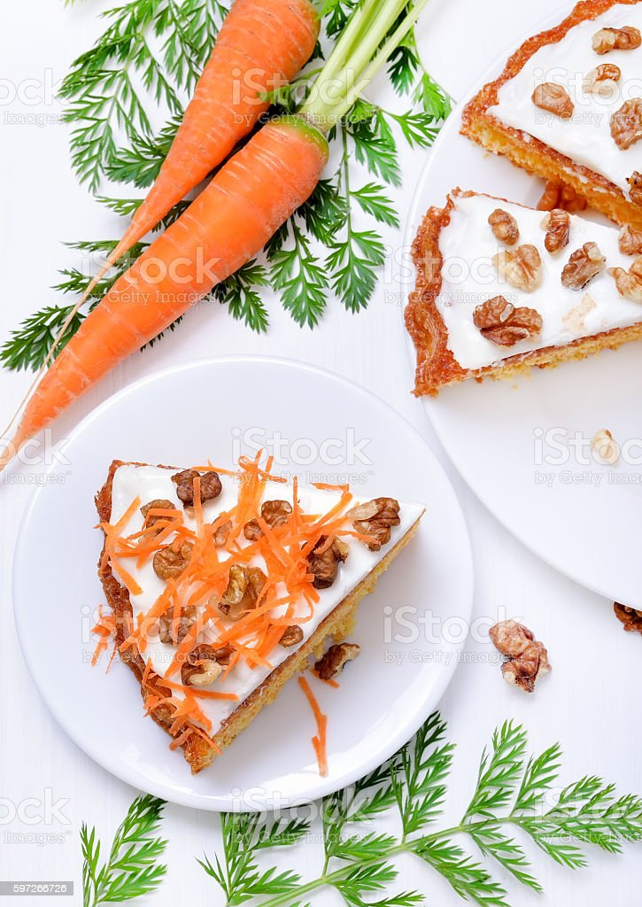 Piece of carrots cake on white plate royalty-free stock photo