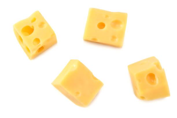 pezzo di formaggio isolato su sfondo bianco. vista dall'alto - maasdam foto e immagini stock