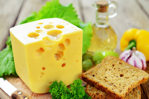 piece of cheese - maasdam foto e immagini stock