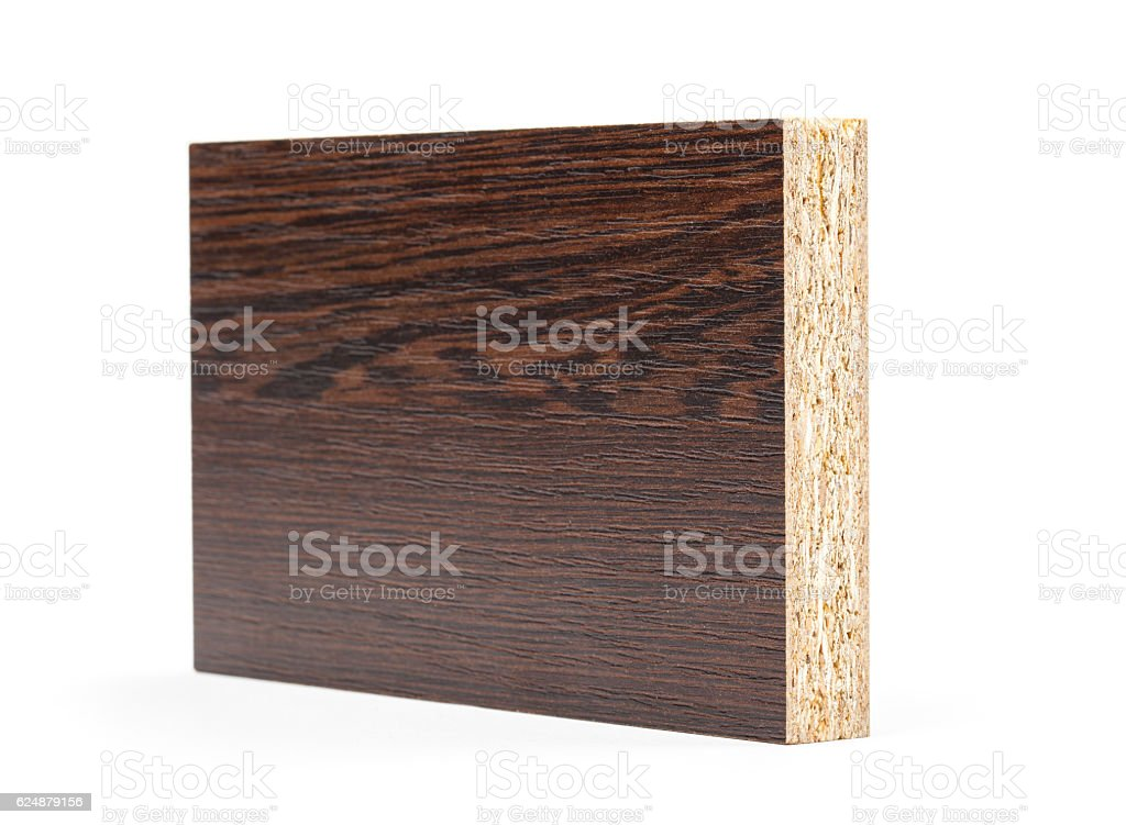 Piece of chipboard with the texture isolated on white background. stock photo