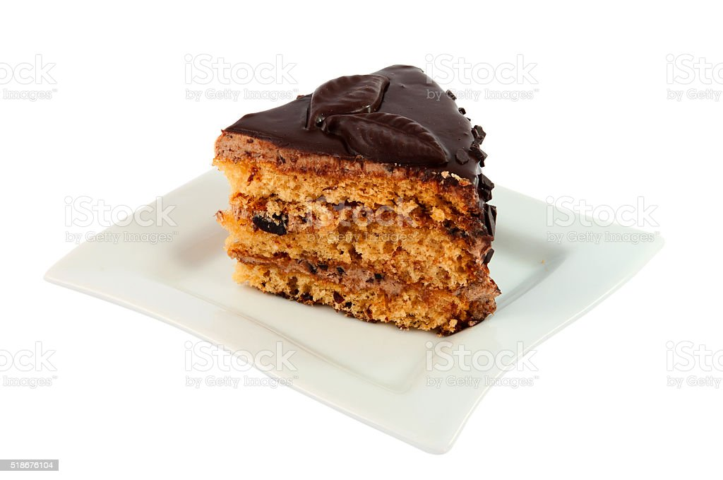 piece of chocolate cake on a plate isolated stock photo