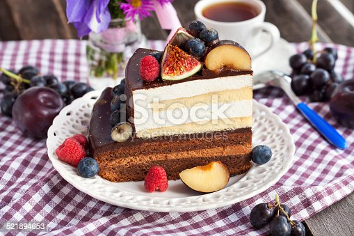 472311978 istock photo Piece of chocolate cake with cream and fresh fruit 521894653