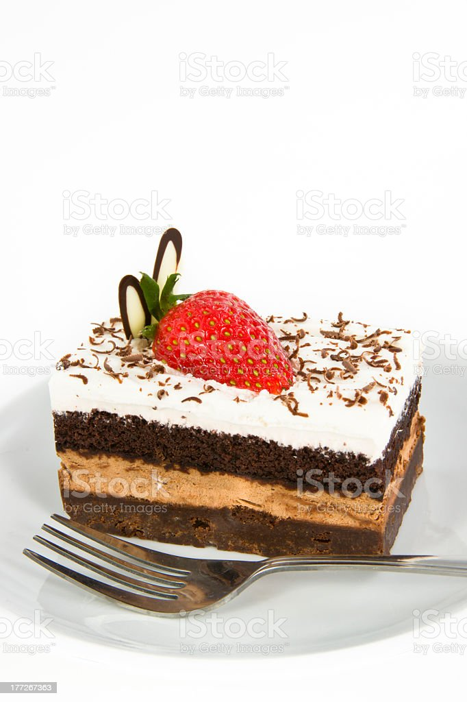 Piece of chocolate cake with strawberry decorate on top royalty-free stock photo
