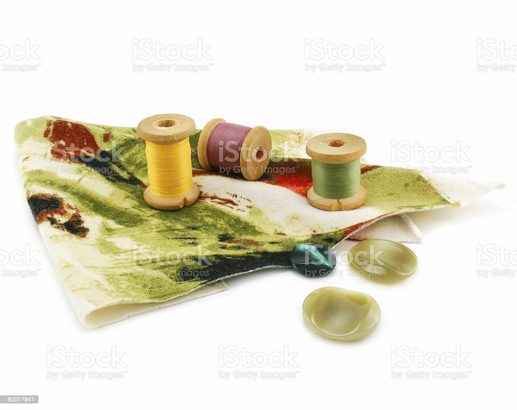Piece of cloth, colored threads and buttons royalty-free stock photo