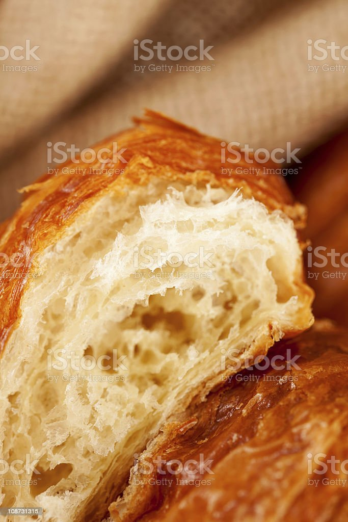piece of croissant pastry, extremely closeup royalty-free stock photo