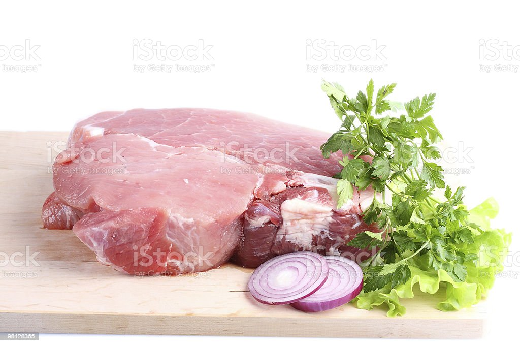 Piece of crude meat with spices royalty-free stock photo