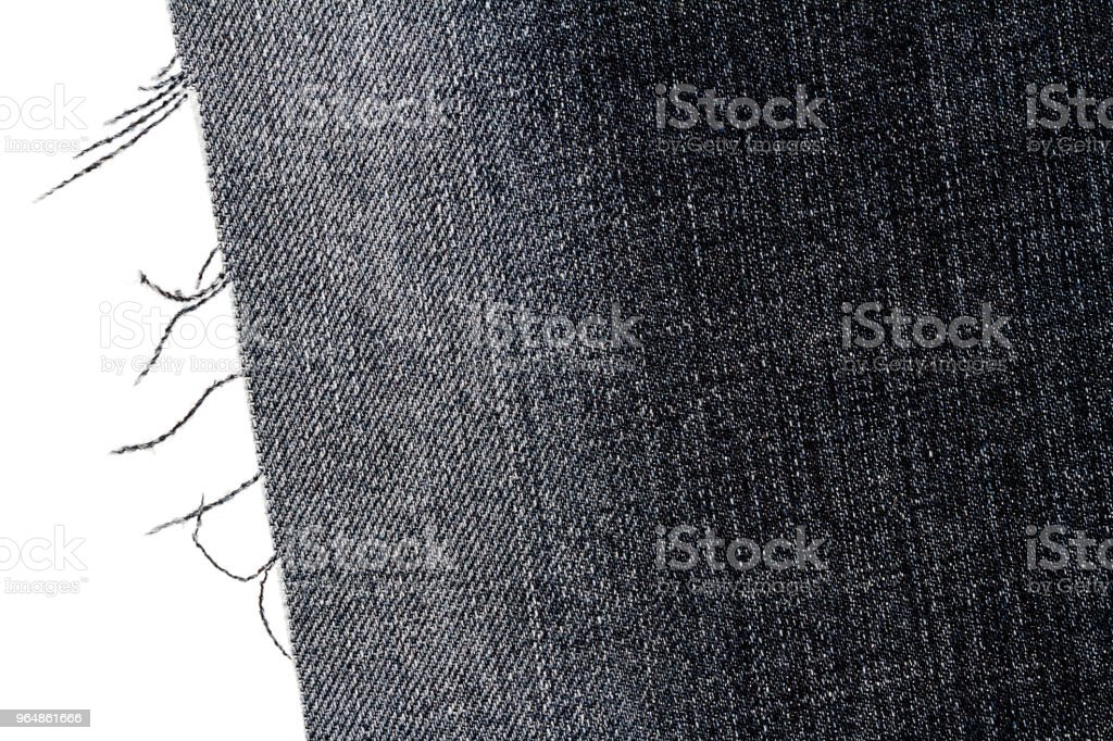 Piece of dark jeans fabric royalty-free stock photo