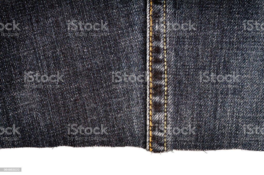 Piece of dark jeans fabric royalty-free stock photo