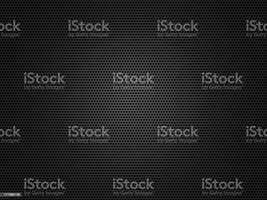 A piece of dark metal mesh with some light reflecting off  stock photo
