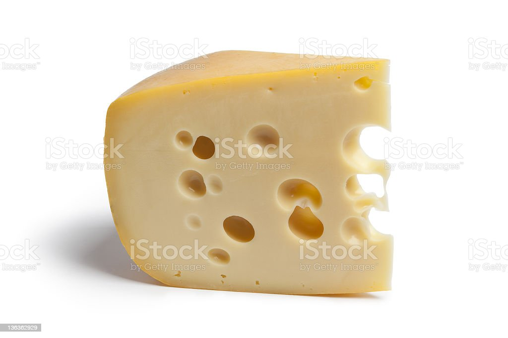 Piece of Dutch farmers cheese with holes stock photo