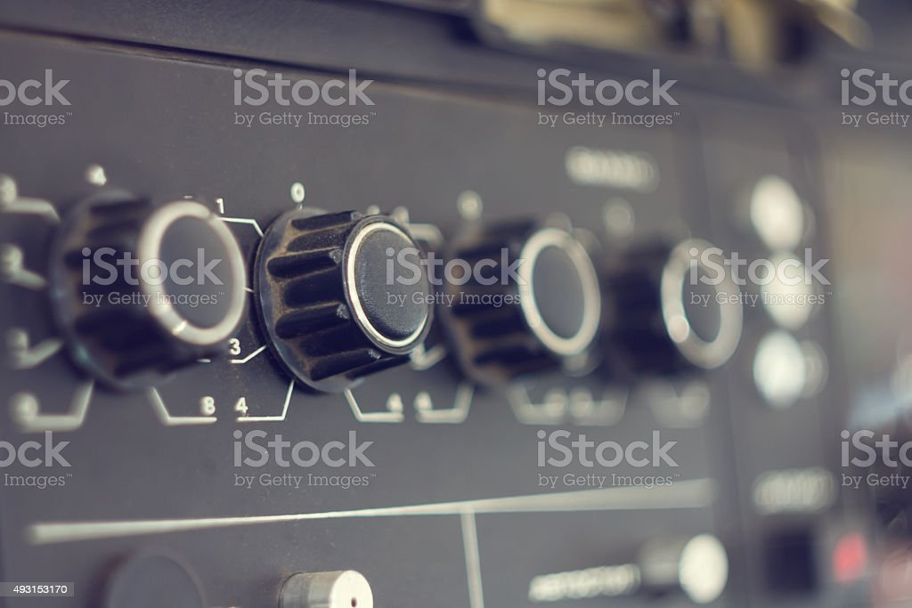 Piece of electrical audio equipment with knobs stock photo