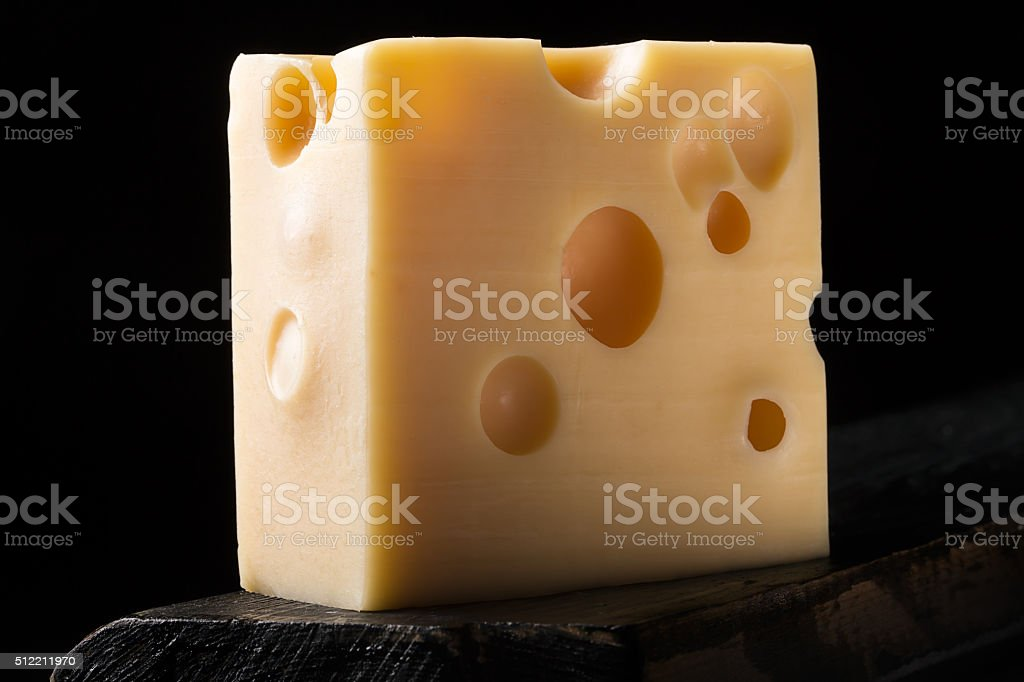 Piece of emmental cheese stock photo