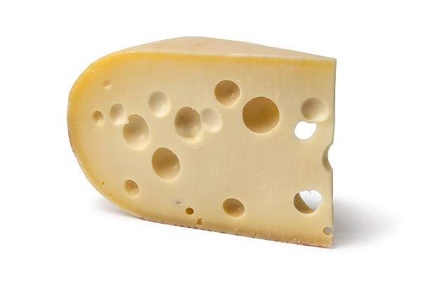piece of emmenthaler cheese - emmentaler foto e immagini stock