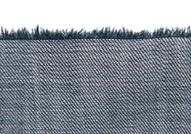 Piece of fabric with fringe on white stock photo