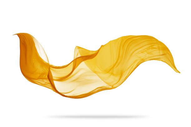 stück von fliegenden goldenen tuch auf weißem hintergrund - satin stock-fotos und bilder