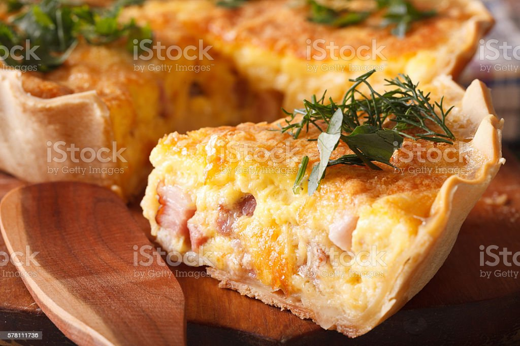piece of French quiche Lorraine macro. horizontal stock photo