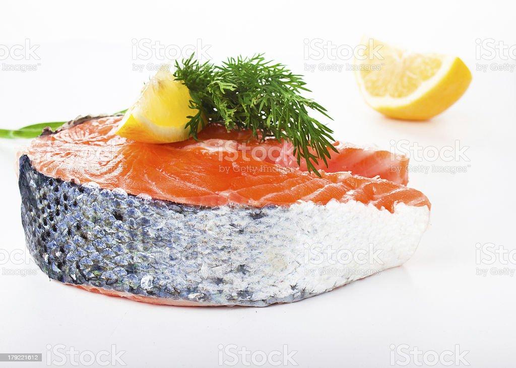 Piece of fresh salmon steak on a white background royalty-free stock photo