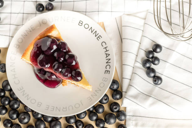 piece of freshness delicious blueberry cheese cake on plate is sweet baked bakery dessert stock photo