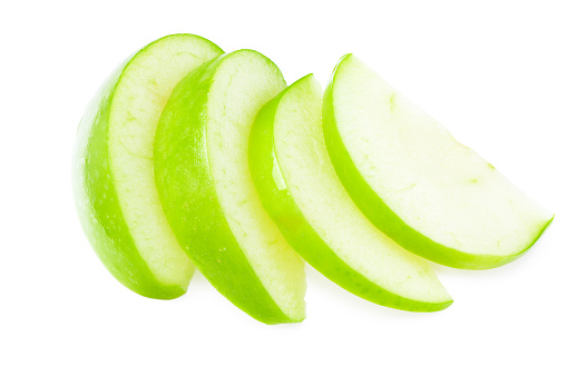 piece of green apple isolated on white background. top view