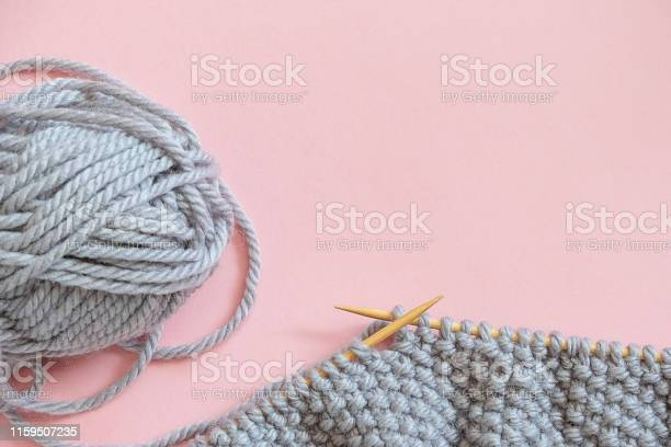 Piece of grey knitted fabric on bamboo wood needles with ball of yarn picture id1159507235?b=1&k=6&m=1159507235&s=612x612&h=i3xicgk4 vfpvnc24wmu2wd6m06magdfgbi9 feiv0q=