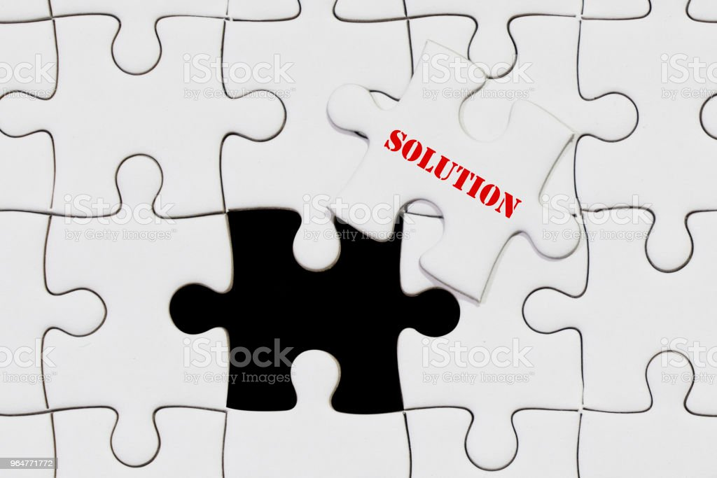 piece of jigsaw puzzle with solution wording for business concept royalty-free stock photo