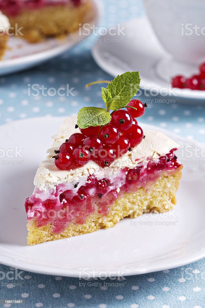 Piece of meringue red currant cake royalty-free stock photo
