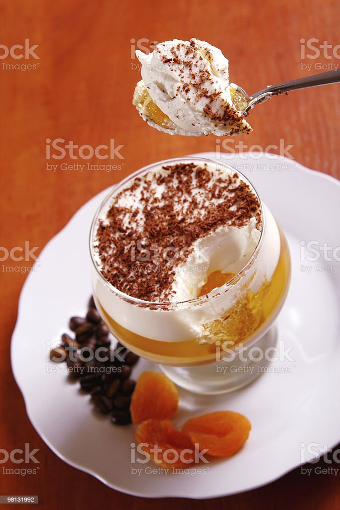 Piece of multilayer gelatin dessert in the spoon royalty-free stock photo