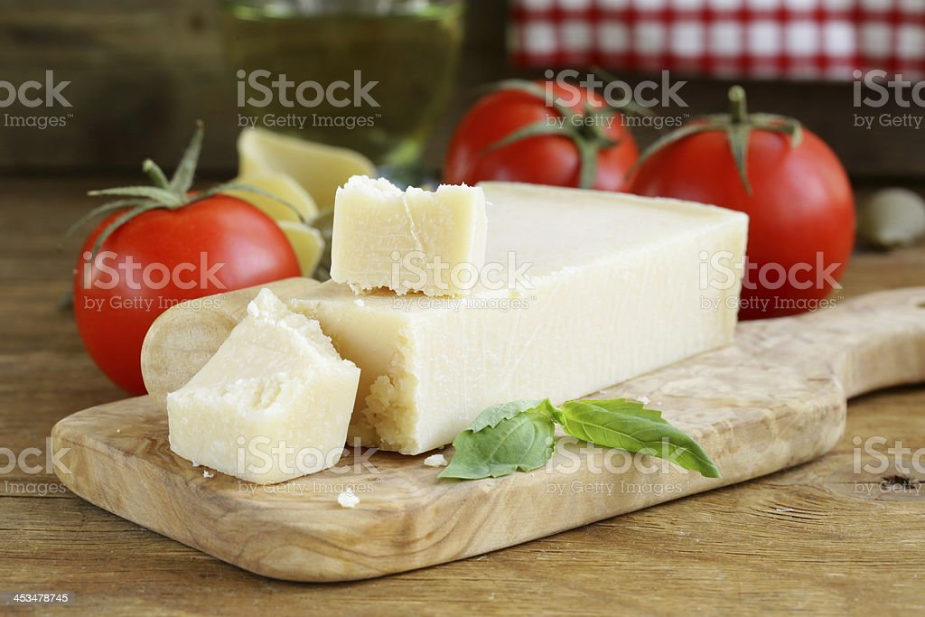 piece of natural parmesan cheese stock photo