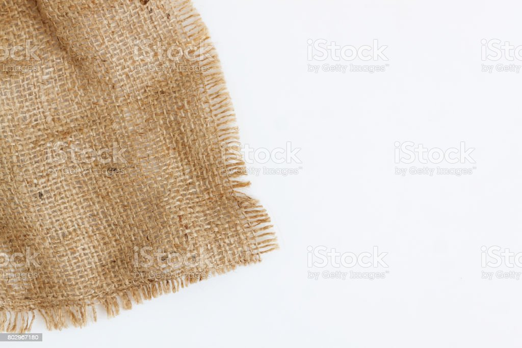 A piece of old burlap, isolated on a white background stock photo