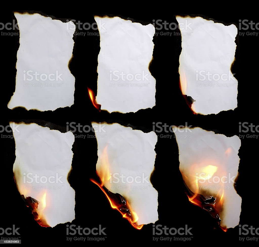 Piece of paper burning in different stages stock photo