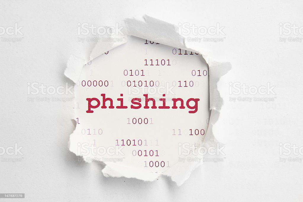 Piece of paper torn with the word phishing in the center stock photo