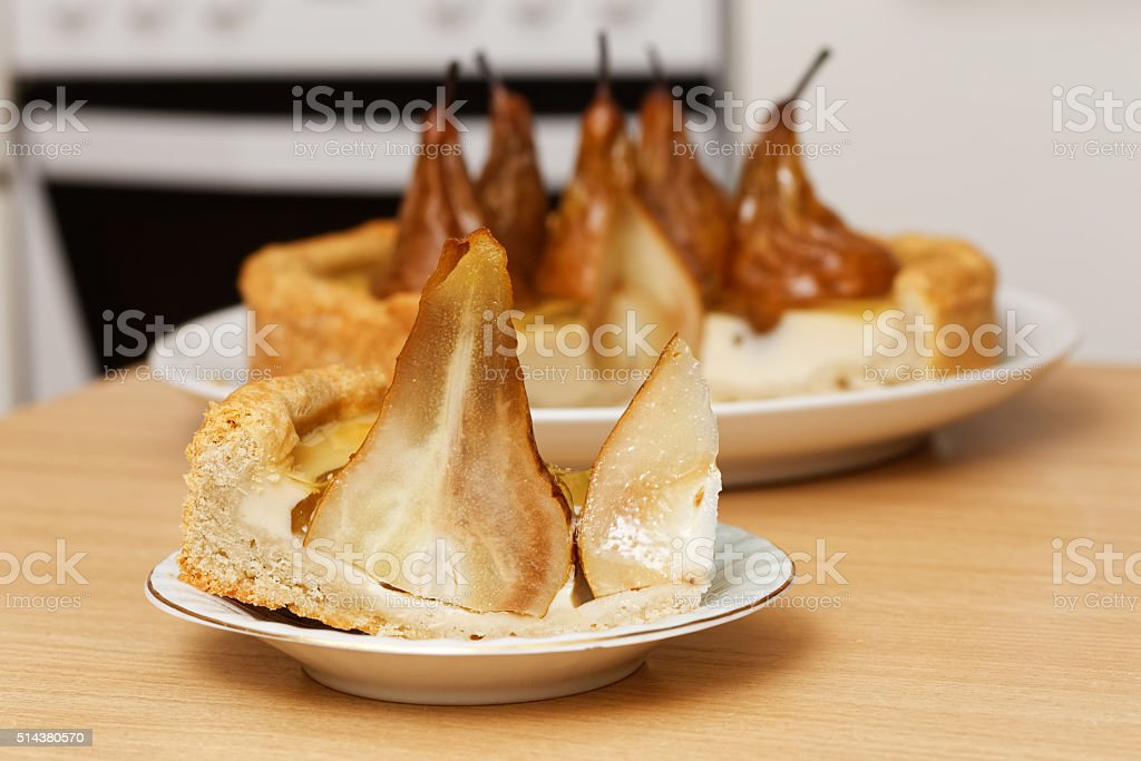 Piece of pie with pears, cream butter and jelly royalty-free stock photo