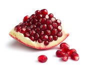 Piece of pomegranate on white backgroundOther fruits and berries: