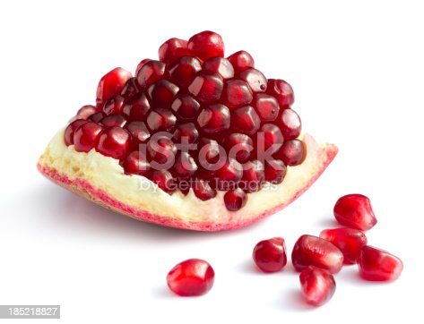 Piece of pomegranate on white backgroundMore fruits and berries: