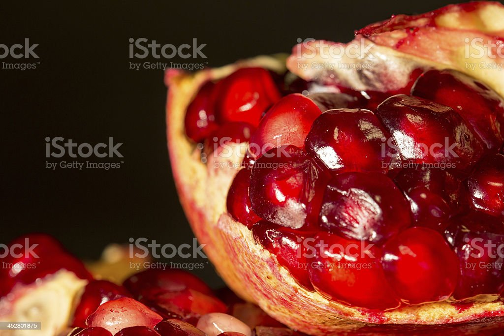 Piece of pomegranate royalty-free stock photo