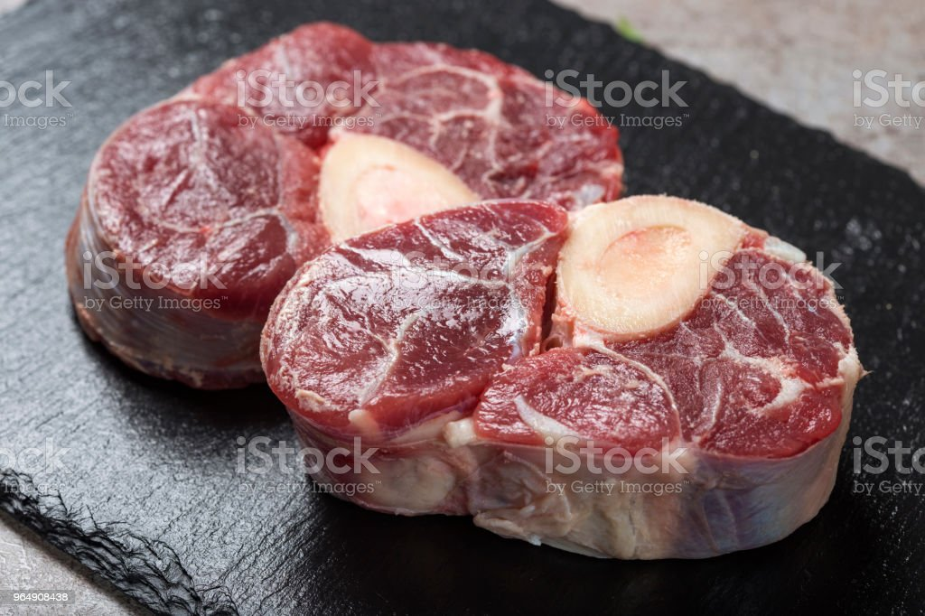 Piece of raw fresh beef shank, lower part of cow's foreleg stock photo