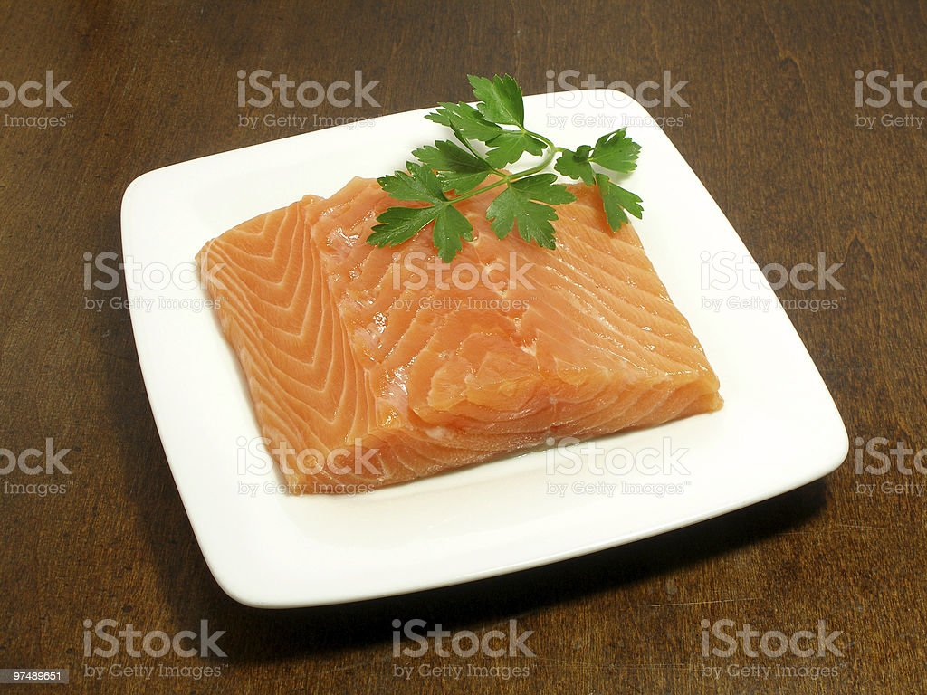 Piece of raw salmon with parsley royalty-free stock photo