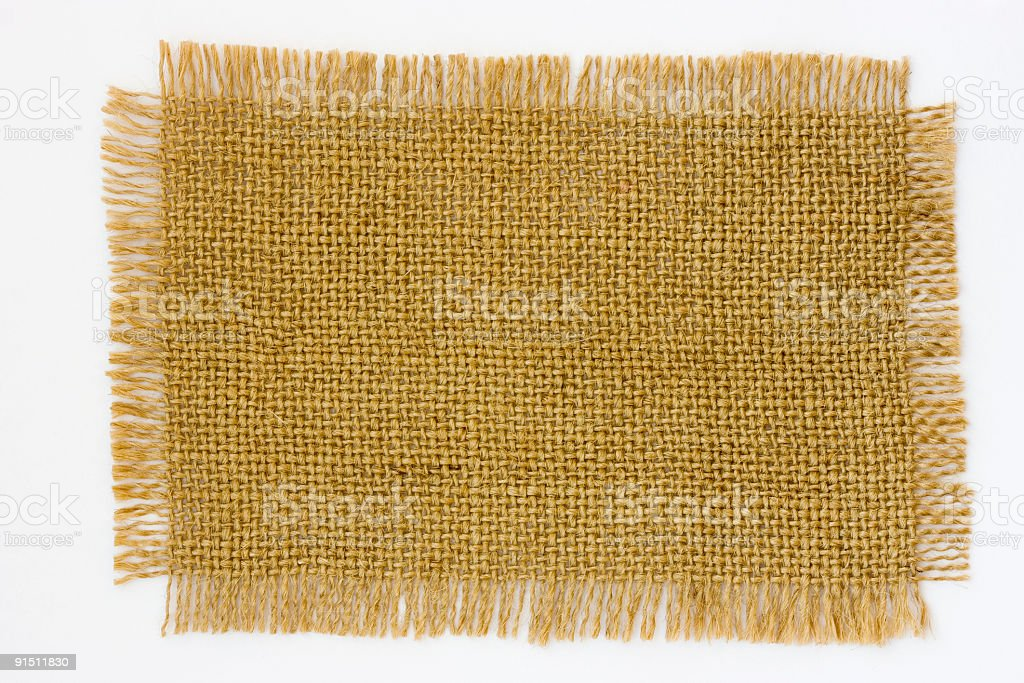 A piece of rough brown cloth with frayed edges royalty-free stock photo