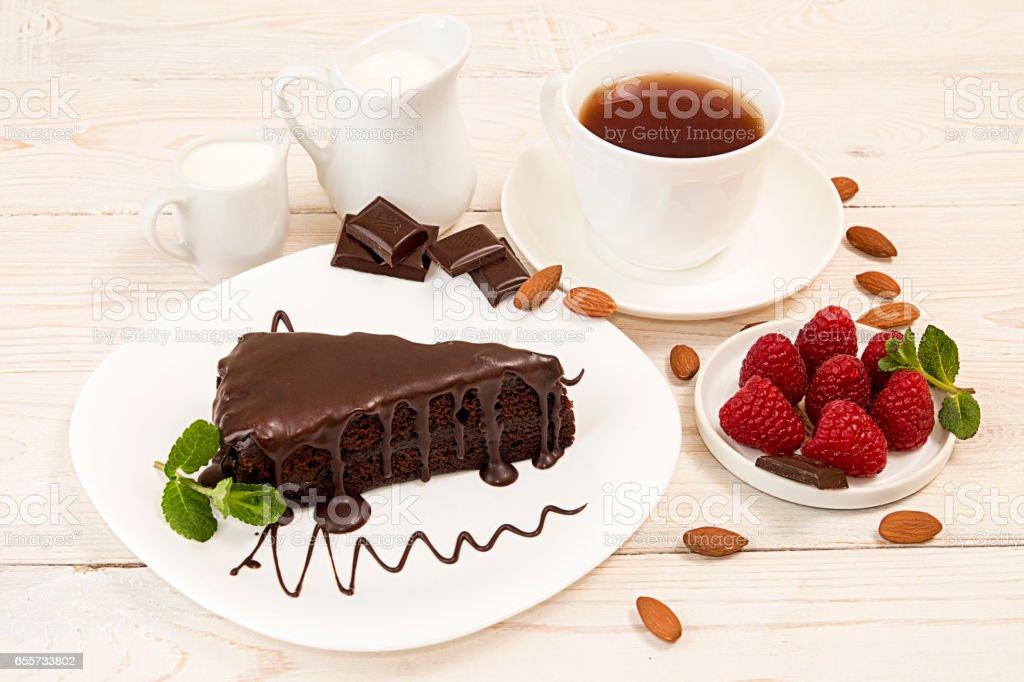 Piece of sacher cake on white plate stock photo