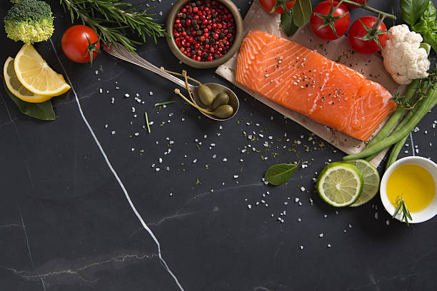 Piece of Salmon Fillet with Ingredients stock photo