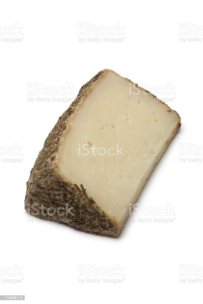 Piece of sheep cheese with rosemary royalty-free stock photo