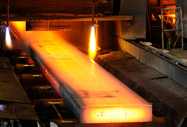 Piece of steel being worked on in a mill stock photo