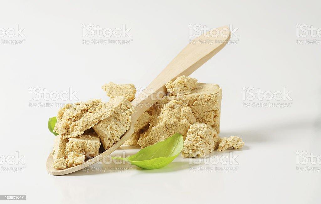 Piece of tasty halva isolated on white royalty-free stock photo