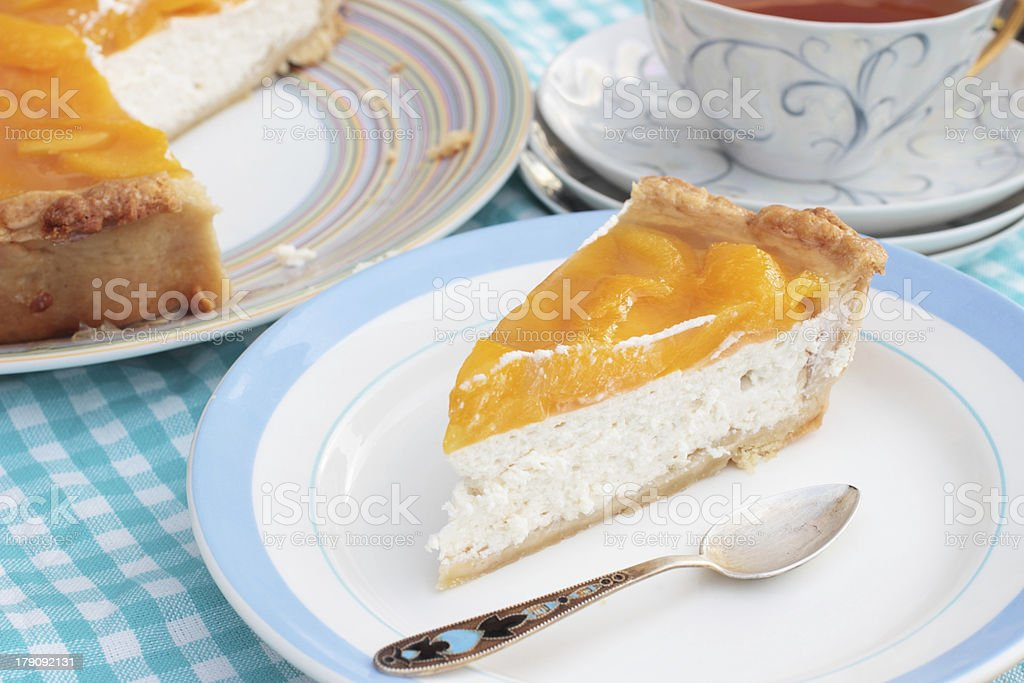 Piece of tasty peach cheesecake with agar jelly royalty-free stock photo